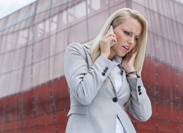 How to Boost Cell Phone Signal Strength for Free - Blonde business woman upset on phone